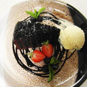 Dark Chocolate Cake With Chocolate Sauce And Ice Cream